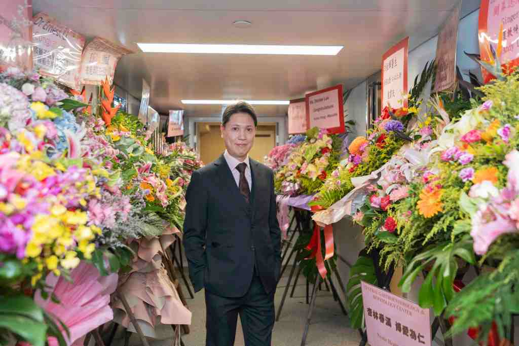 Dr. Ernest Li and flowers